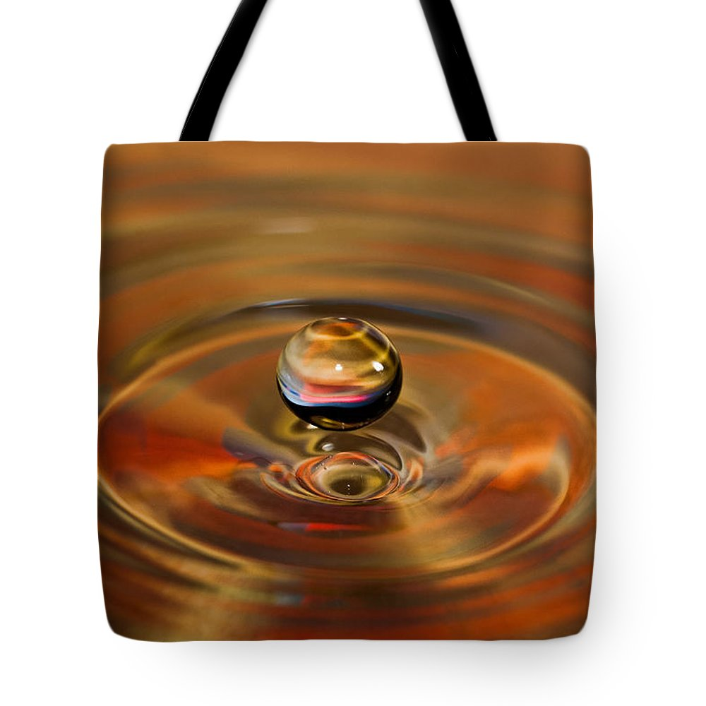 Bcimages Tote Bag featuring the photograph Liquid Orb by Bobbie Climer