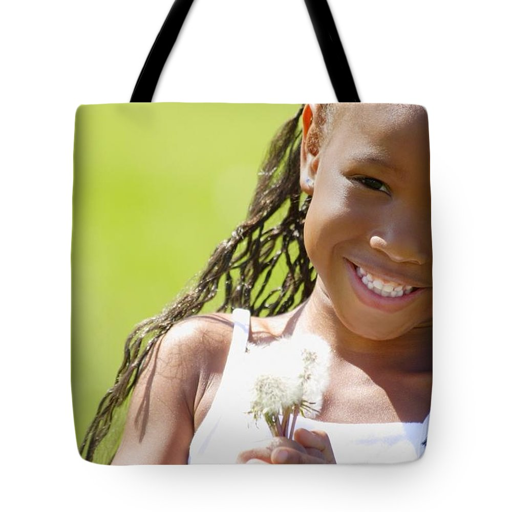 Girl Tote Bag featuring the photograph Little Girl Holding Weeds by Hanson Ng
