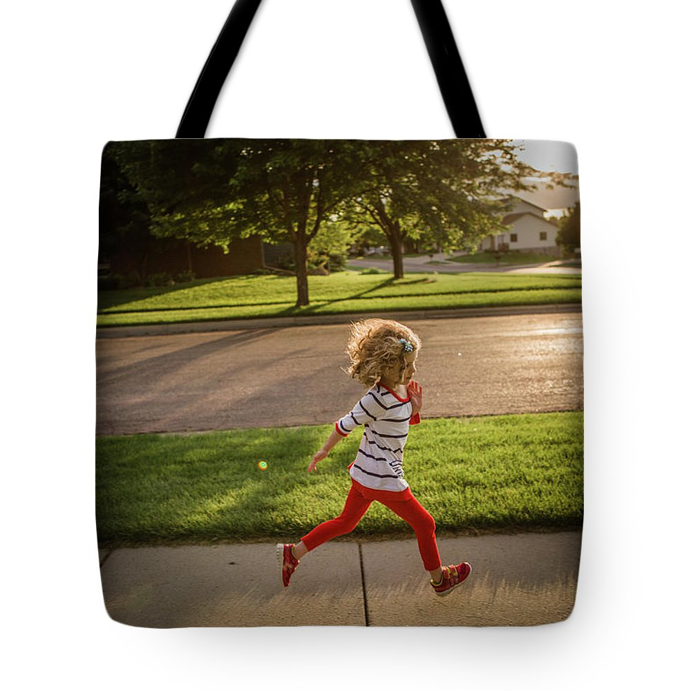 4-5 Years Tote Bag featuring the photograph Little Girl Running by Annie Otzen
