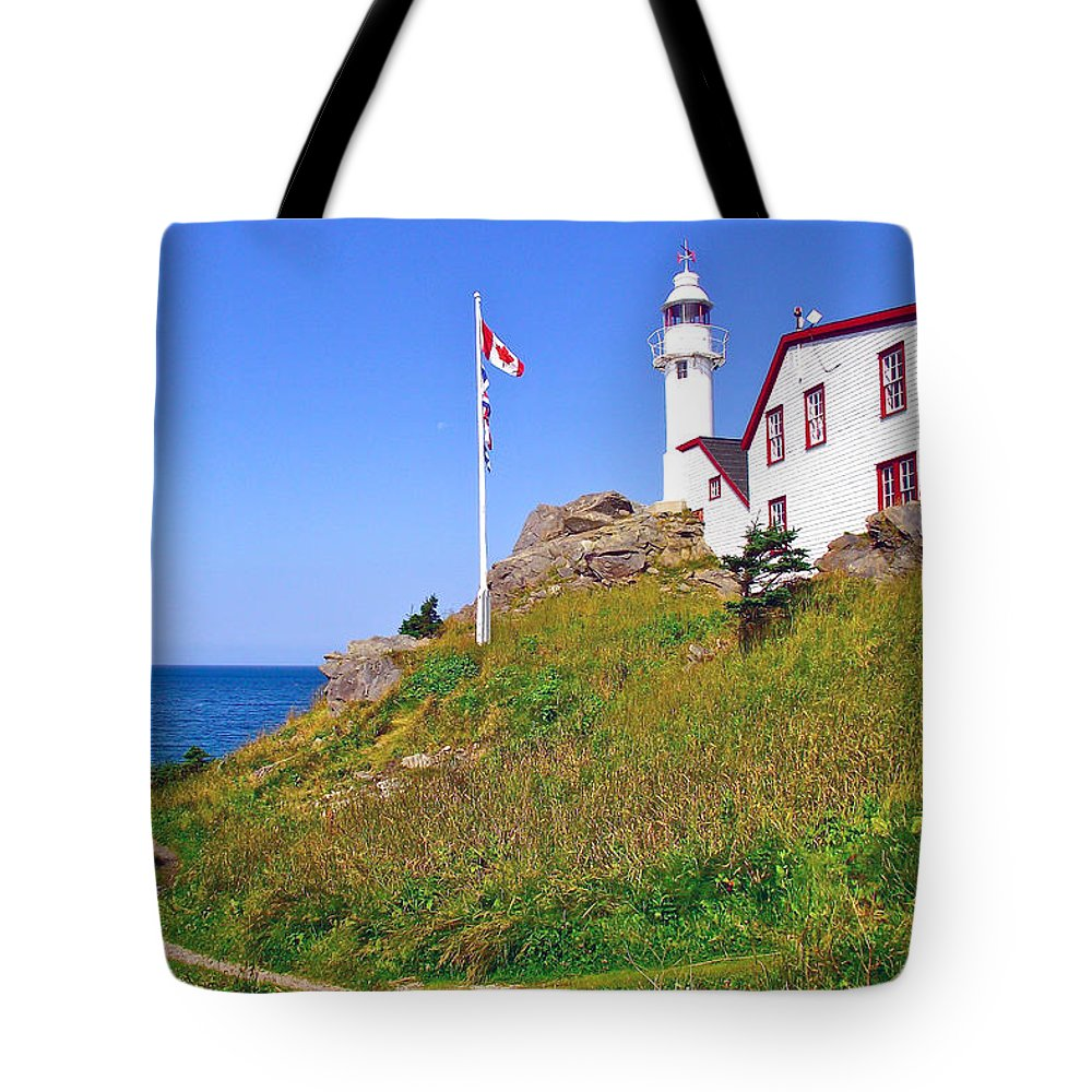 Lobster Cove Head Lighthouse In Gros Morne Np Tote Bag featuring the photograph Lobster Cove Lighthouse With Blue Sky In Gros Morne Np-nl by Ruth Hager