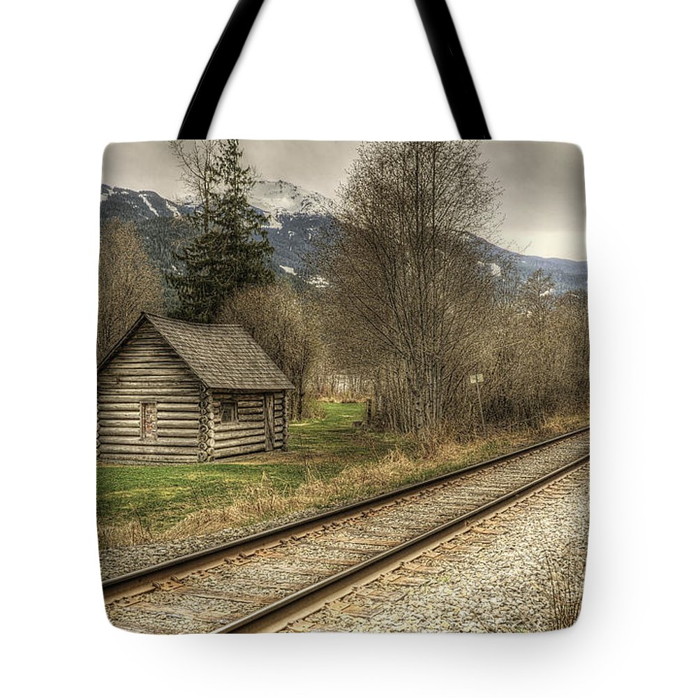 British Columbia Tote Bag featuring the photograph Log Cabin And Railroad Tracks by Claudio Bacinello