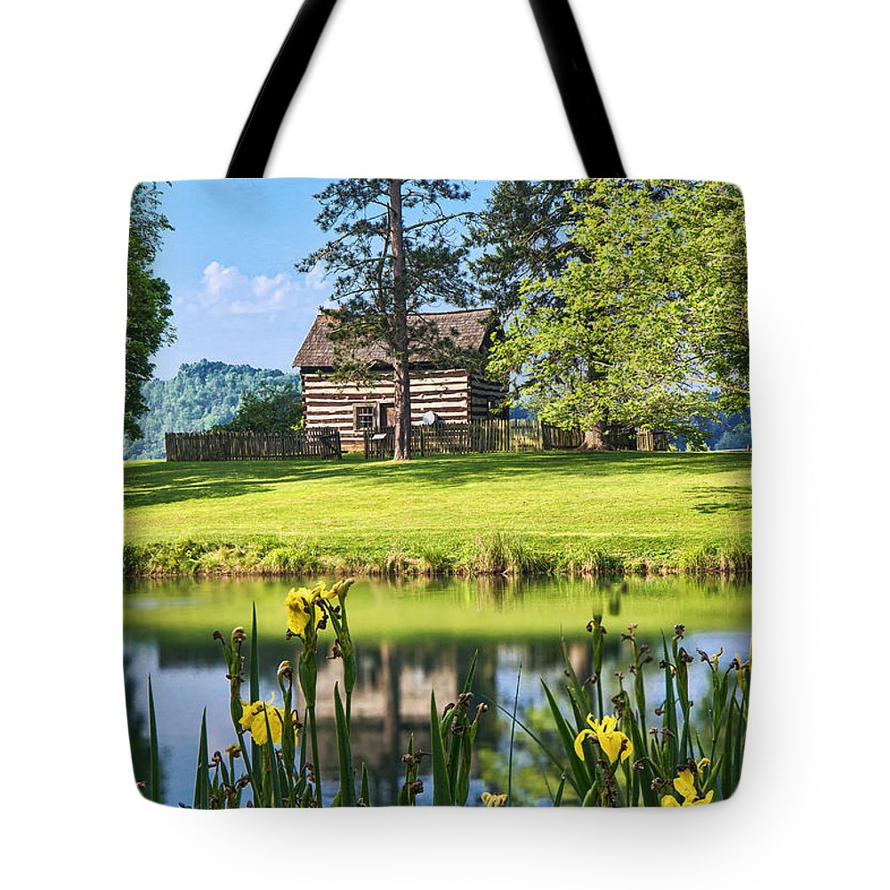 Jackson's Mill Tote Bag featuring the photograph Log Cabin Reflections by Mary Almond