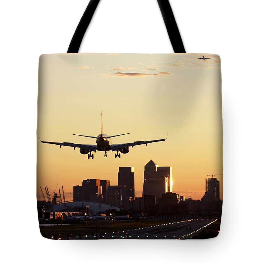Taking Off Tote Bag featuring the photograph London City Airport by Greg Bajor