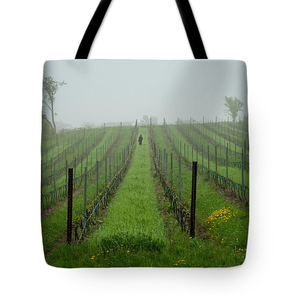 Vine Tote Bag featuring the photograph Lone Figure In Vineyard In The Rain On The Mission Peninsula Michigan by Mary Lee Dereske