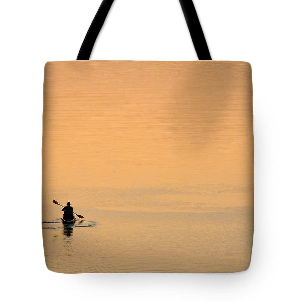 Canoe Tote Bag featuring the photograph Lone Person Canoeing On Lake by Patrick Herrera