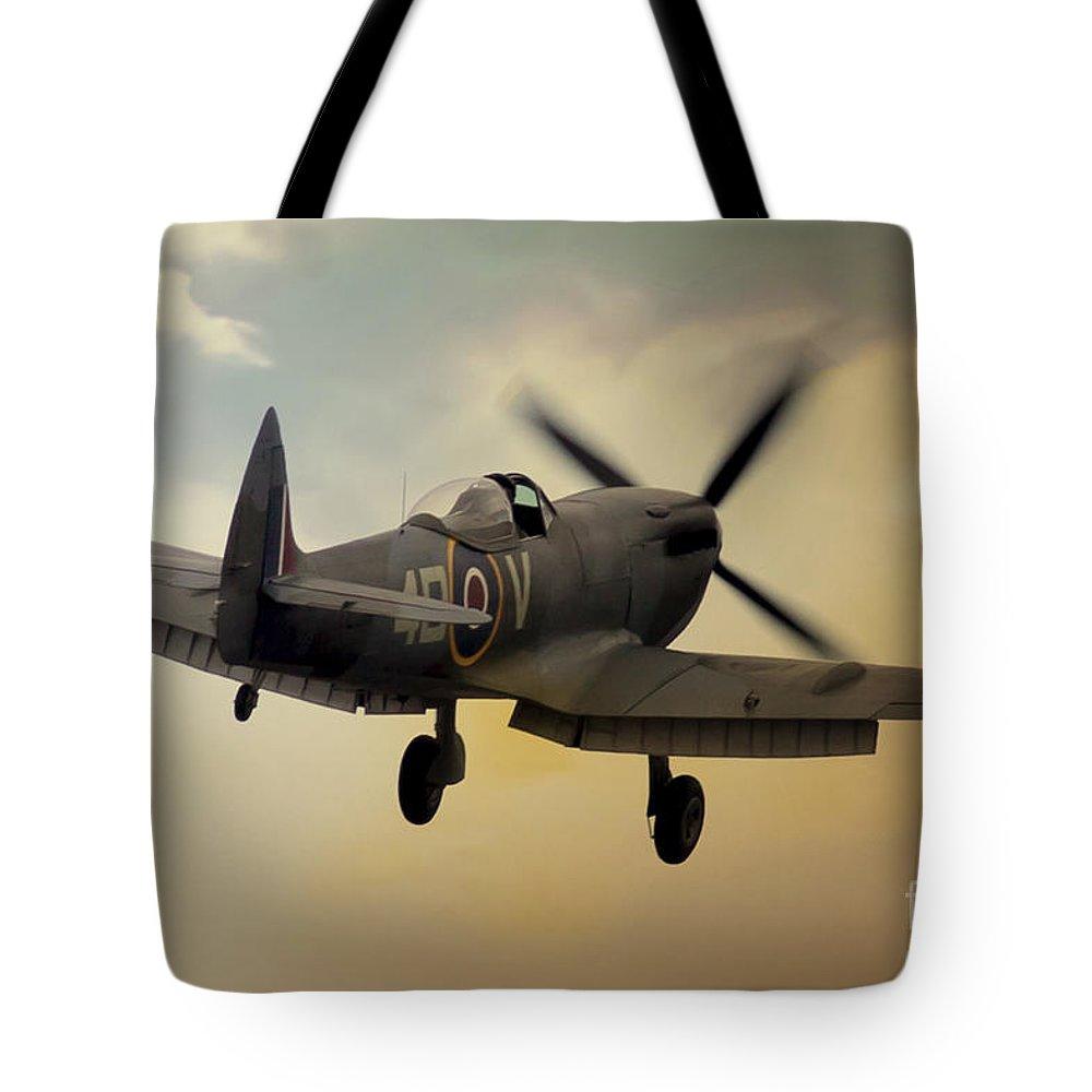 Raf Spitfire Tote Bag featuring the digital art Lone Spitfire by J Biggadike