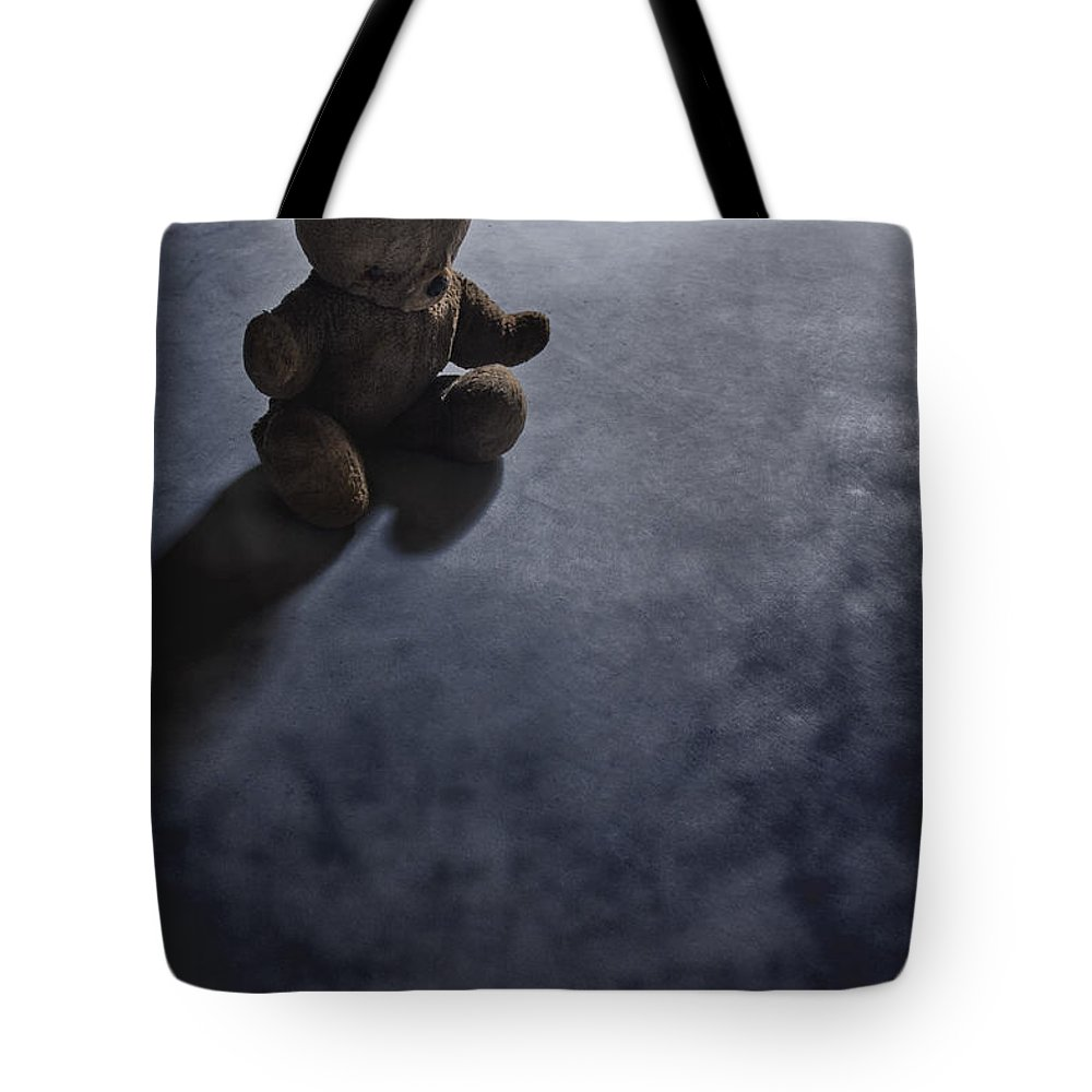 Teddy Bear; Bear; Toy; Sitting; Old; Vintage; Brown; Dirty; Plush; Floor; Cement; Alone; Desolate; Lost; Creepy; Mysterious; Depression; Youth; Shadow; Dark; Childhood Tote Bag featuring the photograph Lost In The Darkness by Margie Hurwich