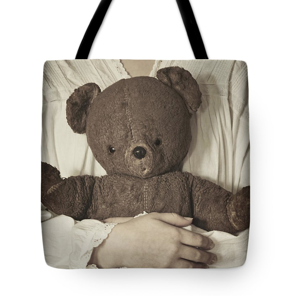 Girl; Female; Teen; Youth; Toddler; Young; Teddy Bear; Bear; Toy; Holding; Night Gown; Close Up; Cuddle; Old; Vintage; Hand; Brown; Dirty; Plush; Looking Down; Face Tote Bag featuring the photograph Love by Margie Hurwich