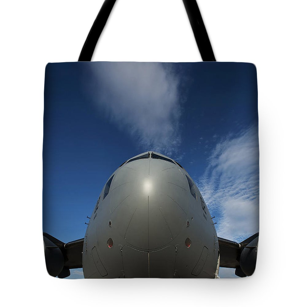 Military Tote Bag featuring the photograph Low Angle View Of A C-17 Globemaster by Stocktrek Images