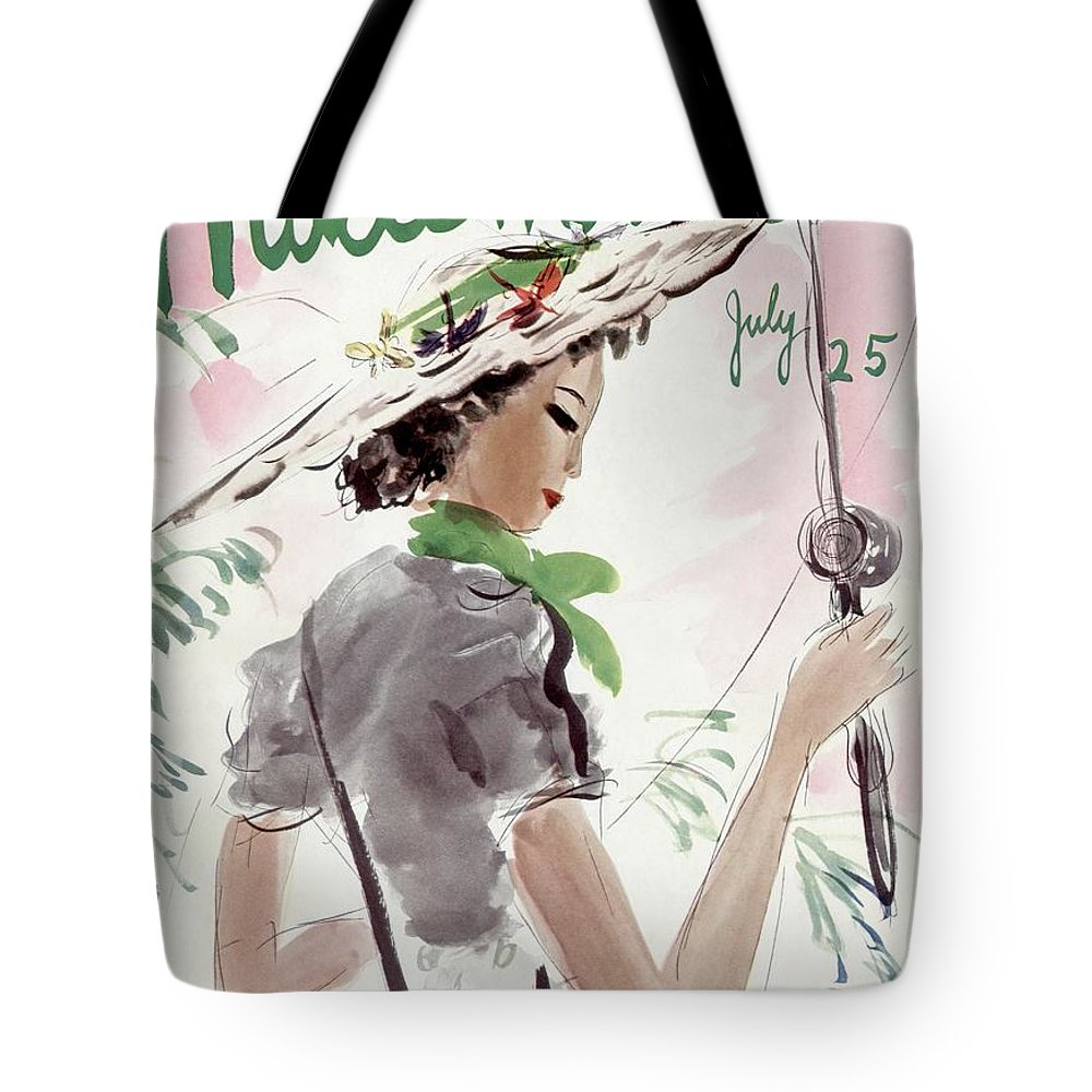 Illustration Tote Bag featuring the photograph Mademoiselle Cover Featuring A Woman Holding by Helen Jameson Hall