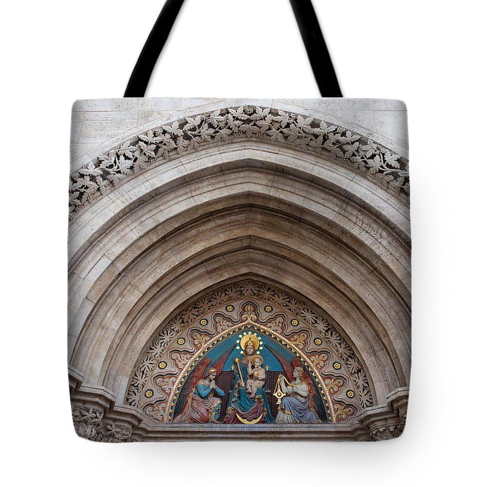 Matthias Tote Bag featuring the photograph Madonna With Child On Matthias Church Tympanum by Artur Bogacki