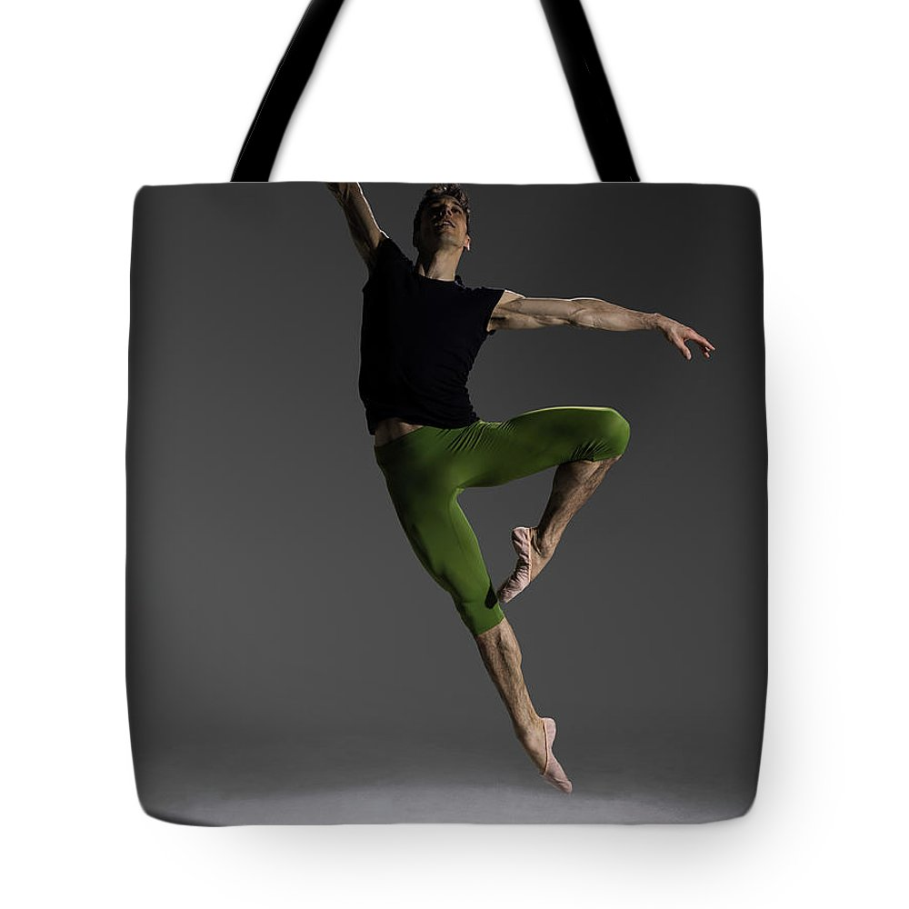 Ballet Dancer Tote Bag featuring the photograph Male Ballet Dancer Jumping In Passé by Nisian Hughes