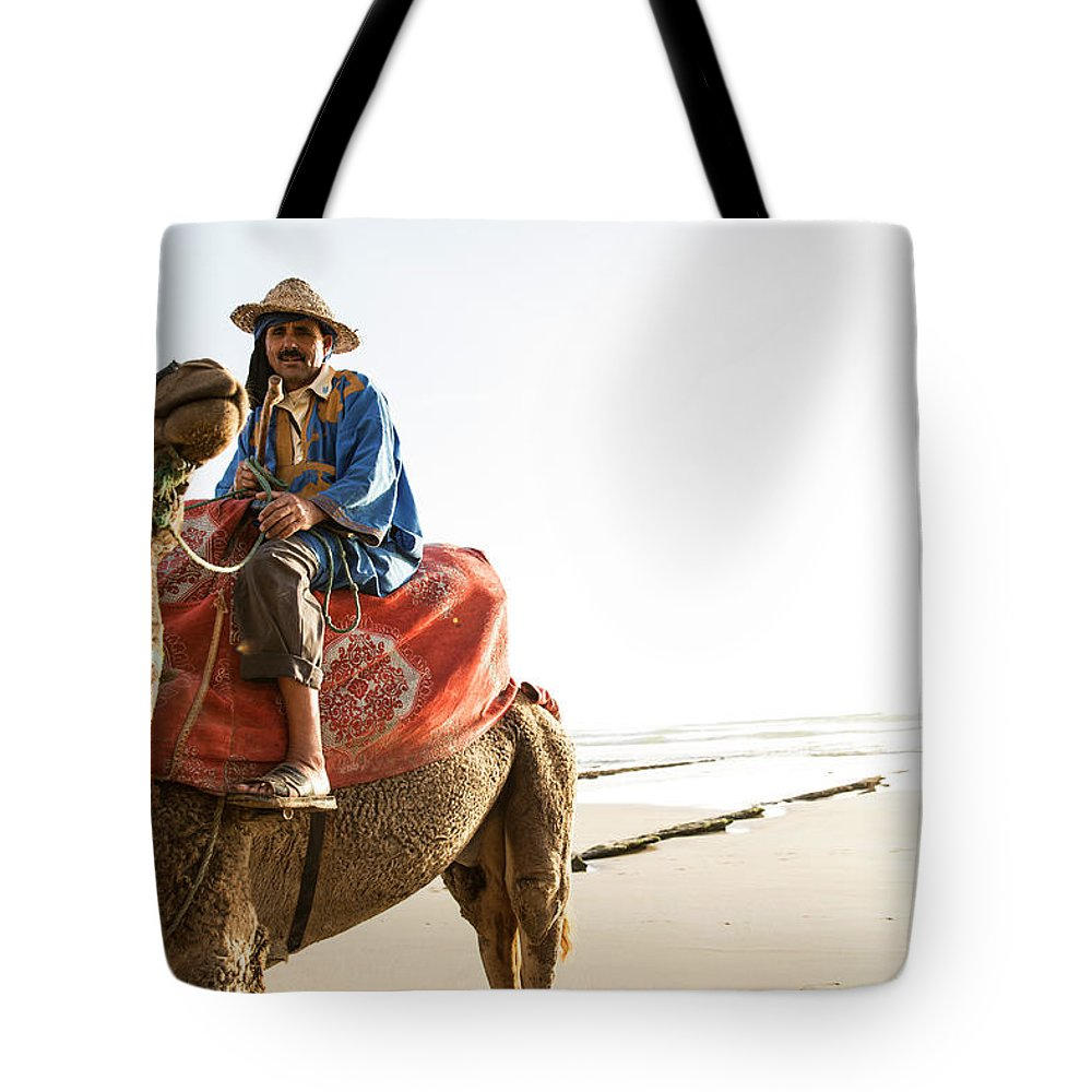 Agadir Tote Bag featuring the photograph Man On Camel On Beach, Taghazout by Tim E White