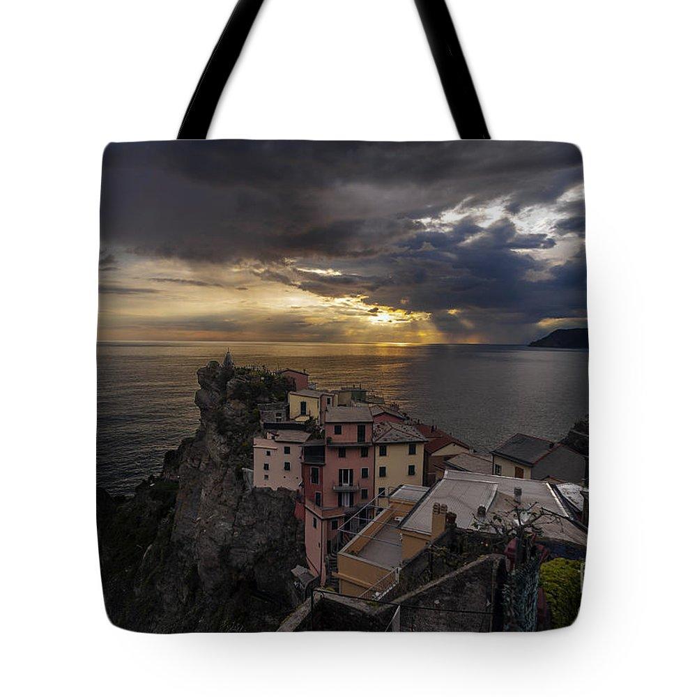 Manarola Tote Bag featuring the Manarola Sunset Storm by Mike Reid