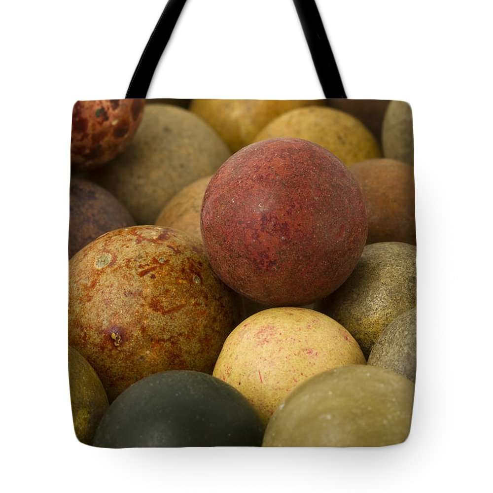 Clay Tote Bag featuring the photograph Marbles Clay 2 by John Brueske
