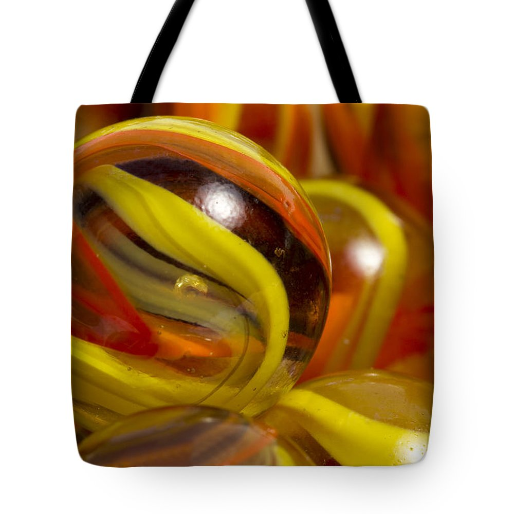 Glass Tote Bag featuring the photograph Marbles Mega Sunflower 1 by John Brueske