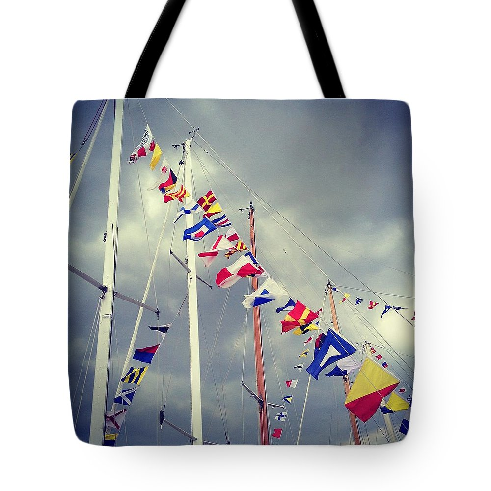 Pole Tote Bag featuring the photograph Marine Signal Flags On Mast Against A by Jodie Griggs