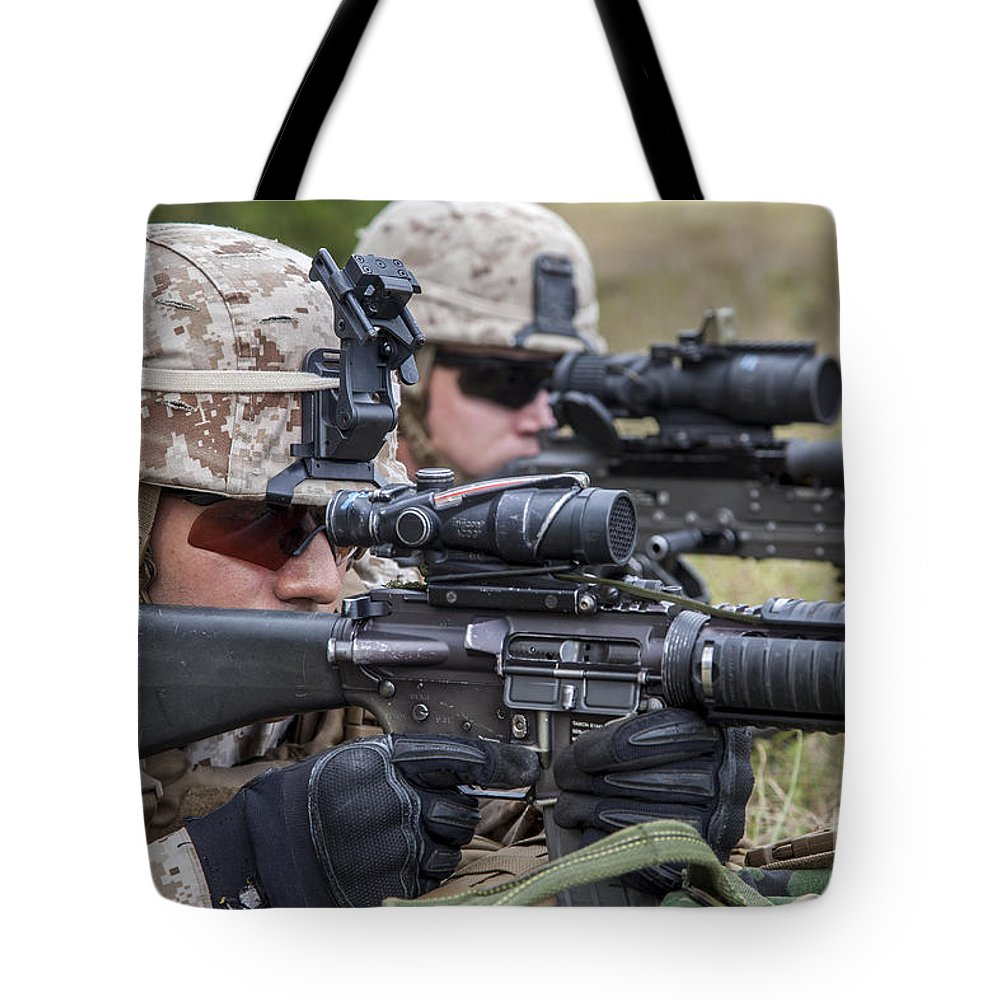 Us Marine Corps Tote Bag featuring the photograph Marines And Sailors Wait For A Ch-53e by Stocktrek Images