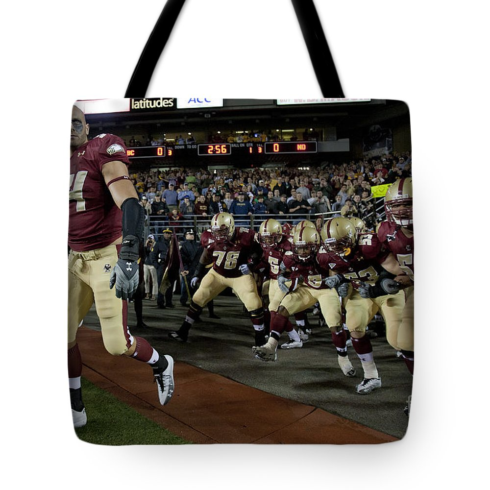 Sports Equipment Tote Bag featuring the photograph Mark Herzlich by Jason O Watson