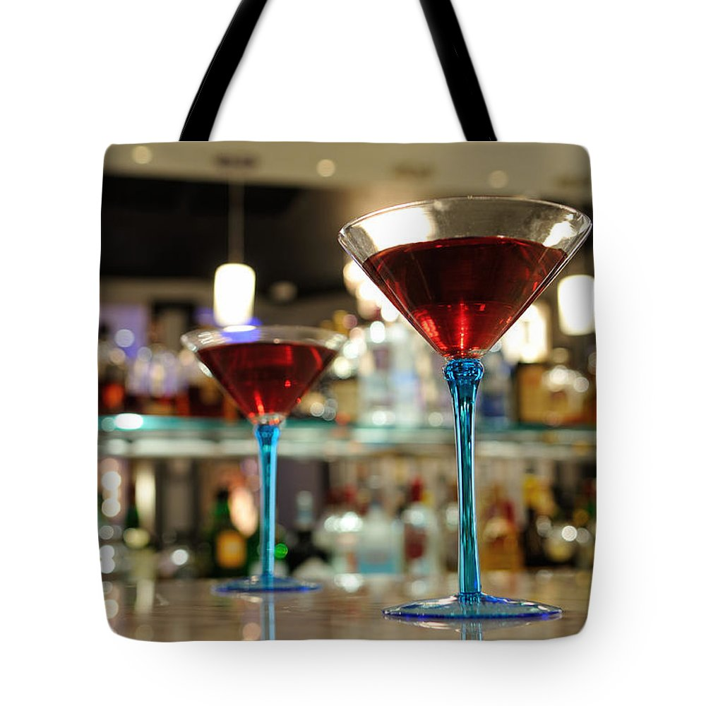 Bar Counter Tote Bag featuring the photograph Martini Glasses In Bar by Patrick Herrera