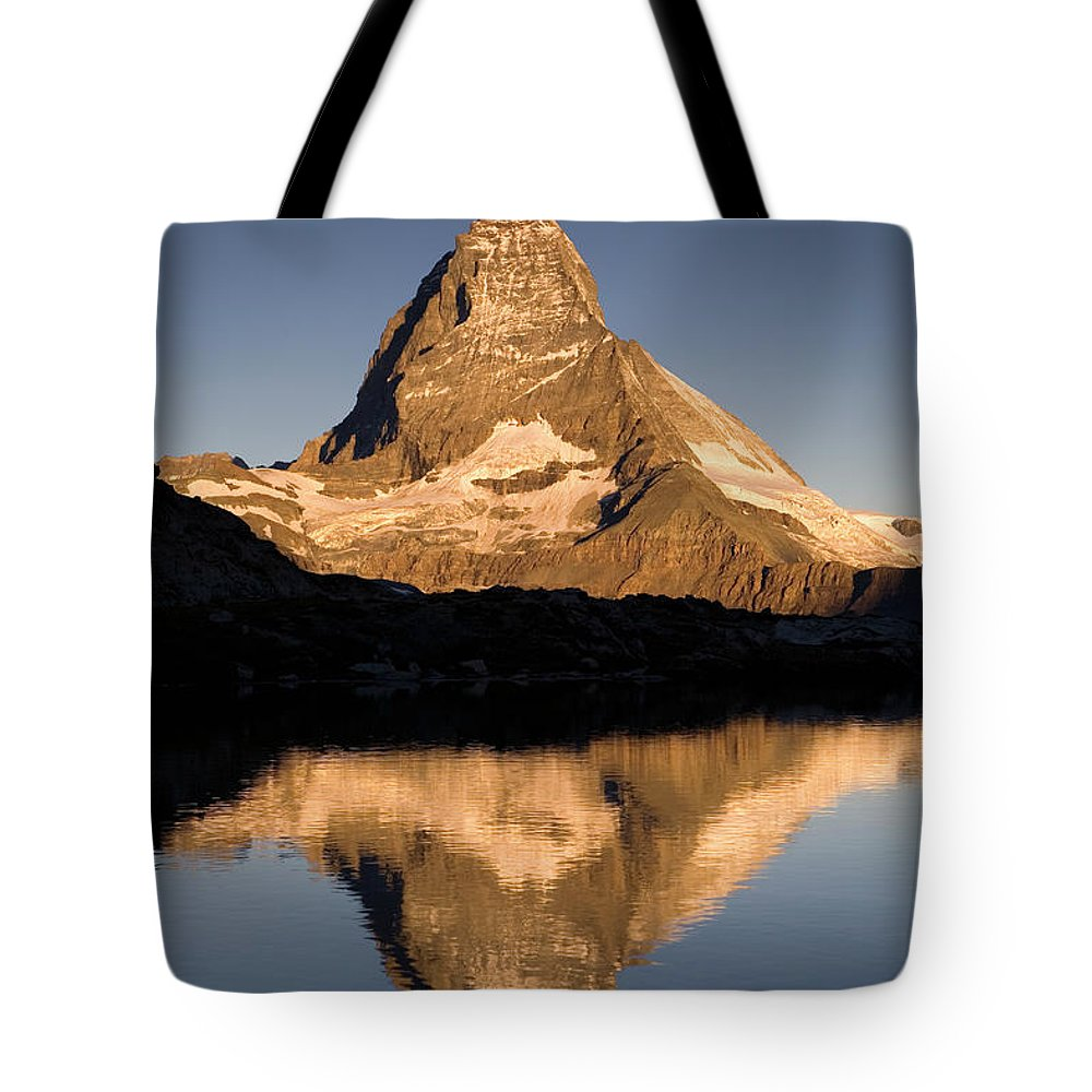 Color Image Tote Bag featuring the photograph Matterhorn Reflected In Riffelsee Lake by Ingo Arndt