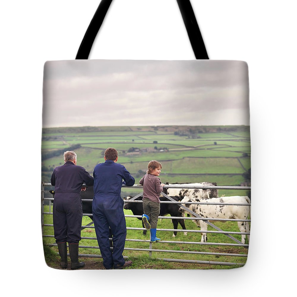 Mature Adult Tote Bag featuring the photograph Mature Farmer, Adult Son And Grandson by Monty Rakusen