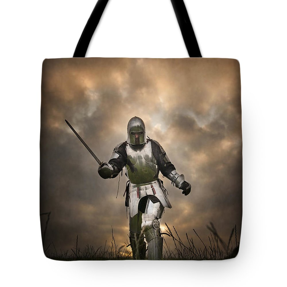 Knight Tote Bag featuring the photograph Medieval Knight In Armour On The Attack by Lee Avison