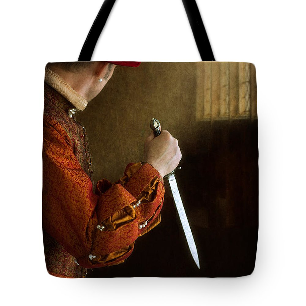 Medieval Tote Bag featuring the photograph Medieval Man With Dagger by Lee Avison
