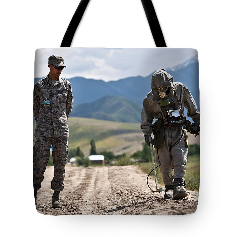 Kyrgyzstan Tote Bag featuring the photograph Member Of The Kyrgyz Republic Searches by Stocktrek Images
