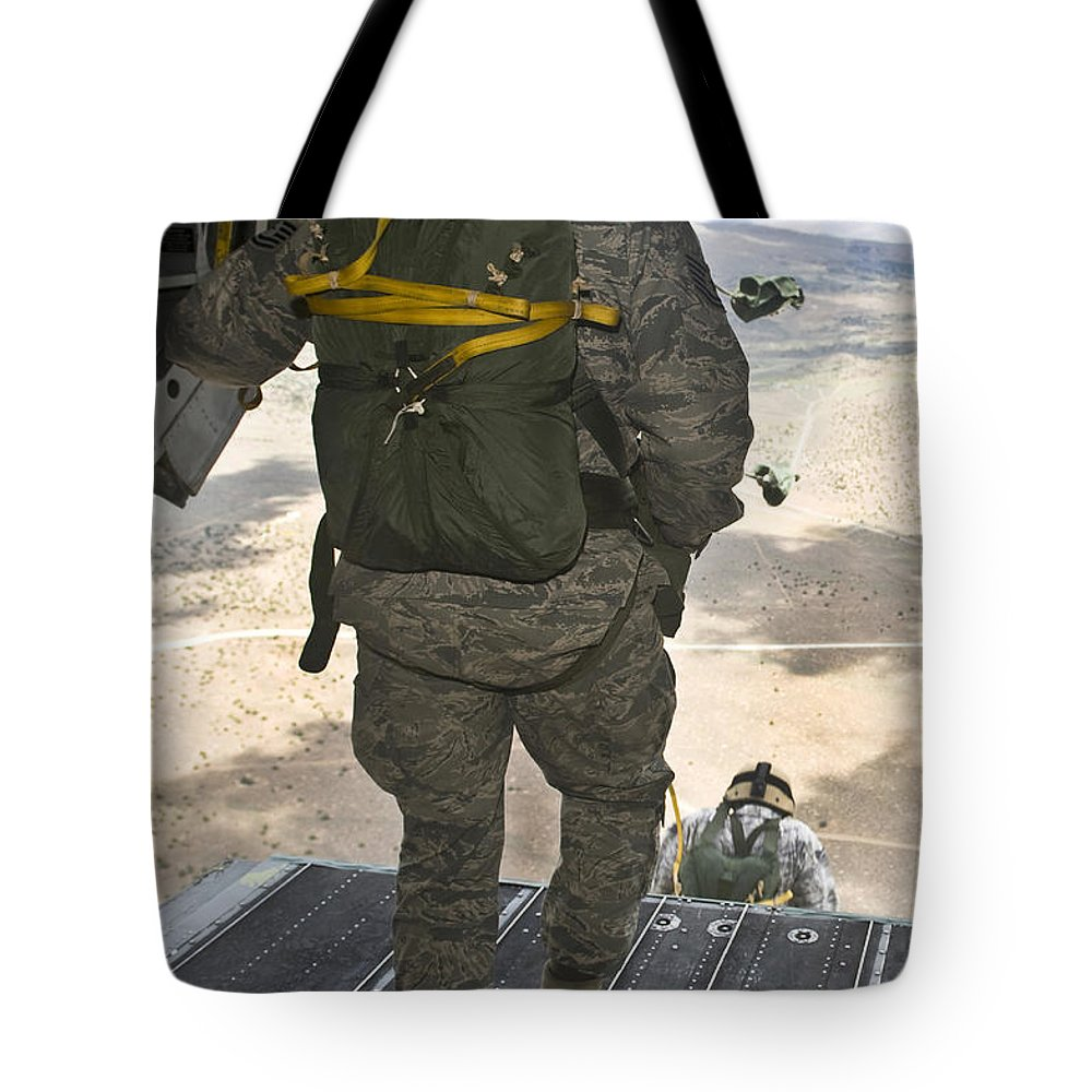 Nellis Air Force Base Tote Bag featuring the photograph Members Of The 820th Red Horse Squadron by Stocktrek Images