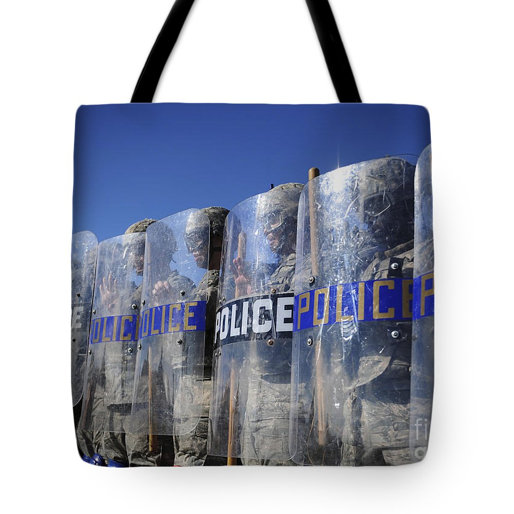 Military Tote Bag featuring the photograph Members Of The 9th Security Forces by Stocktrek Images
