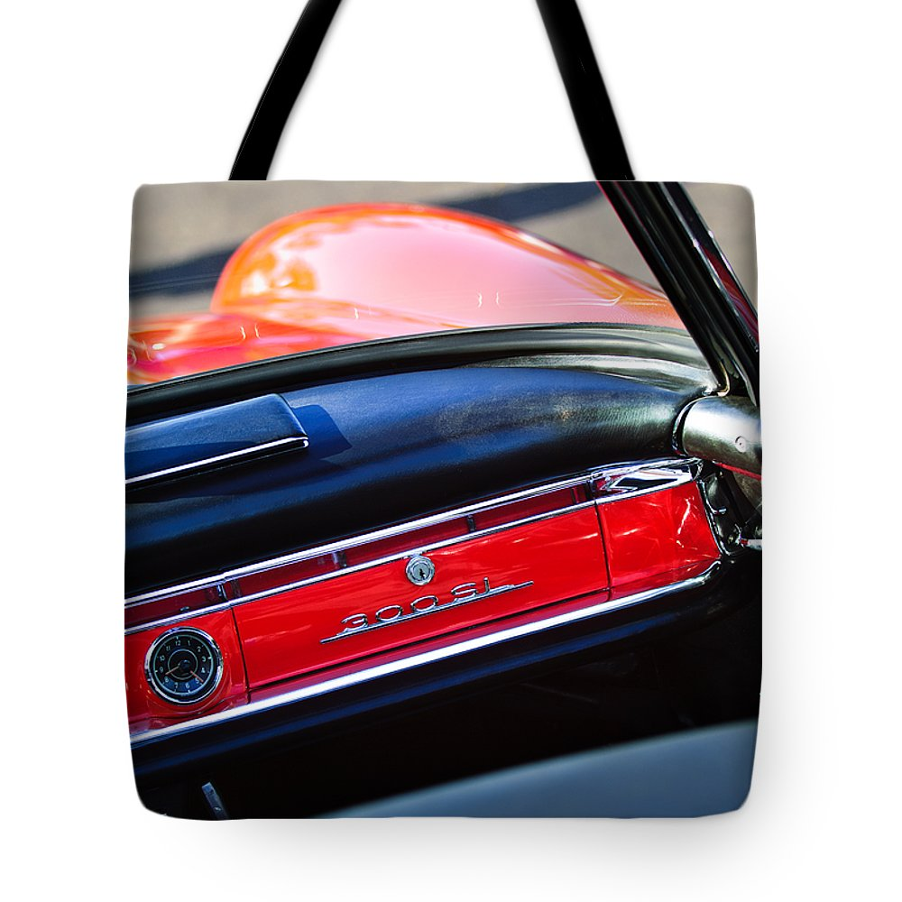 Mercedes 300 Sl Dashboard Emblem Tote Bag featuring the photograph Mercedes 300 Sl Dashboard Emblem by Jill Reger