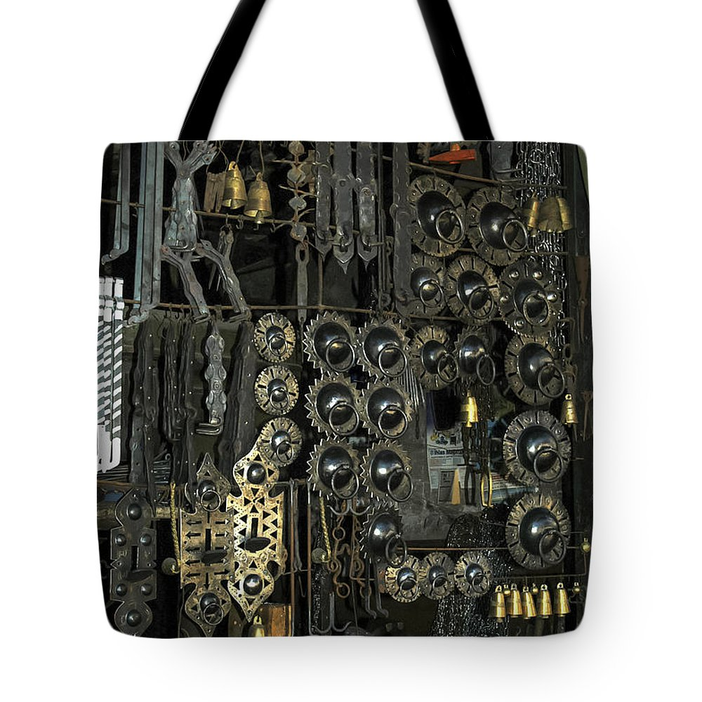 Door Knocker Knockers Horse Shoe Shoes Metal Work Shop Shops Store Stores Safranbolu Turkey Odds And Ends City Cities Cityscape Cityscapes Tote Bag featuring the photograph Metal Work by Bob Phillips