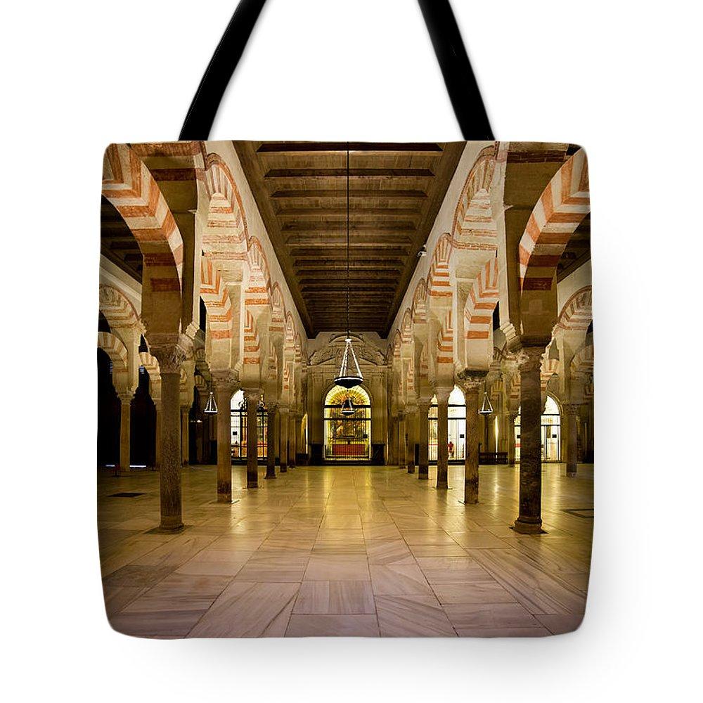 Cordoba Tote Bag featuring the photograph Mezquita Interior In Cordoba by Artur Bogacki