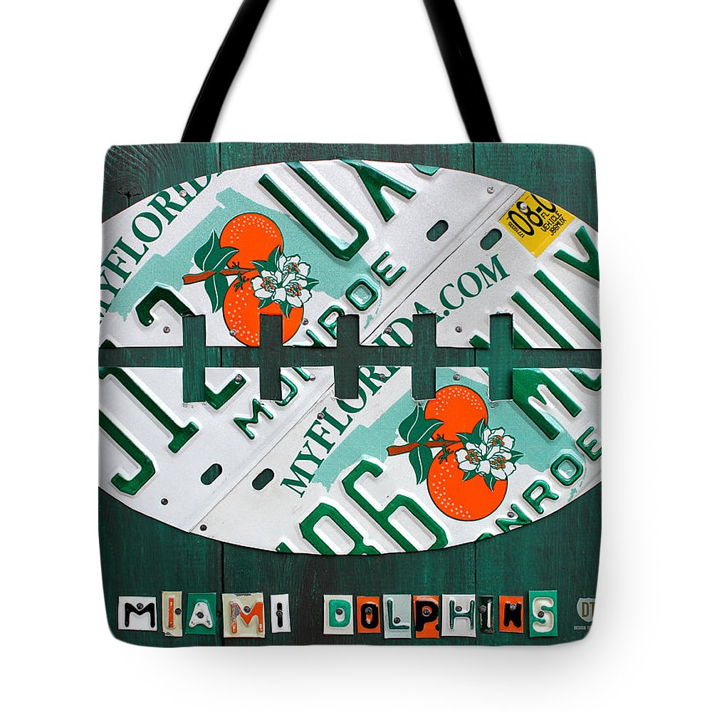 Miami Tote Bag featuring the mixed media Miami Dolphins Football Recycled License Plate Art by Design Turnpike