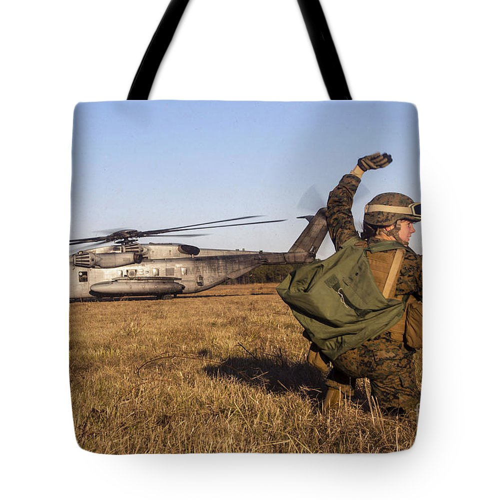 Military Tote Bag featuring the photograph Military Policeman Signals To The Other by Stocktrek Images