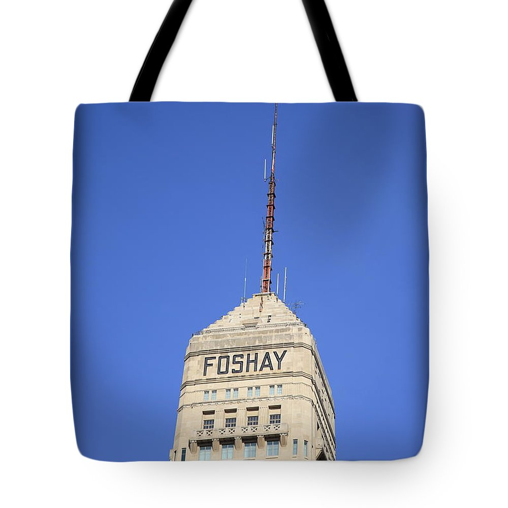 America Tote Bag featuring the photograph Minneapolis Tower by Frank Romeo