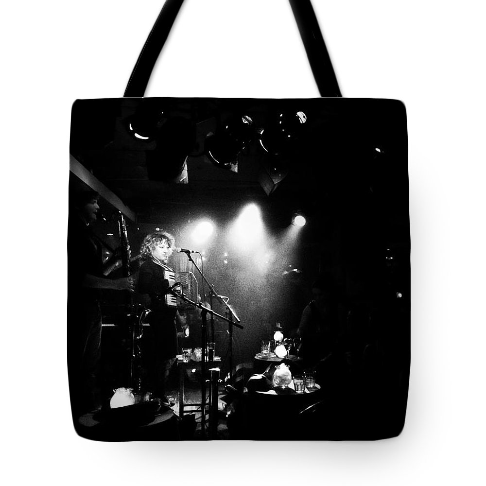 Mira Stroika Tote Bag featuring the photograph Mira Stroika And The Red Scare At Carnival Des Corbeaux by Natasha Marco