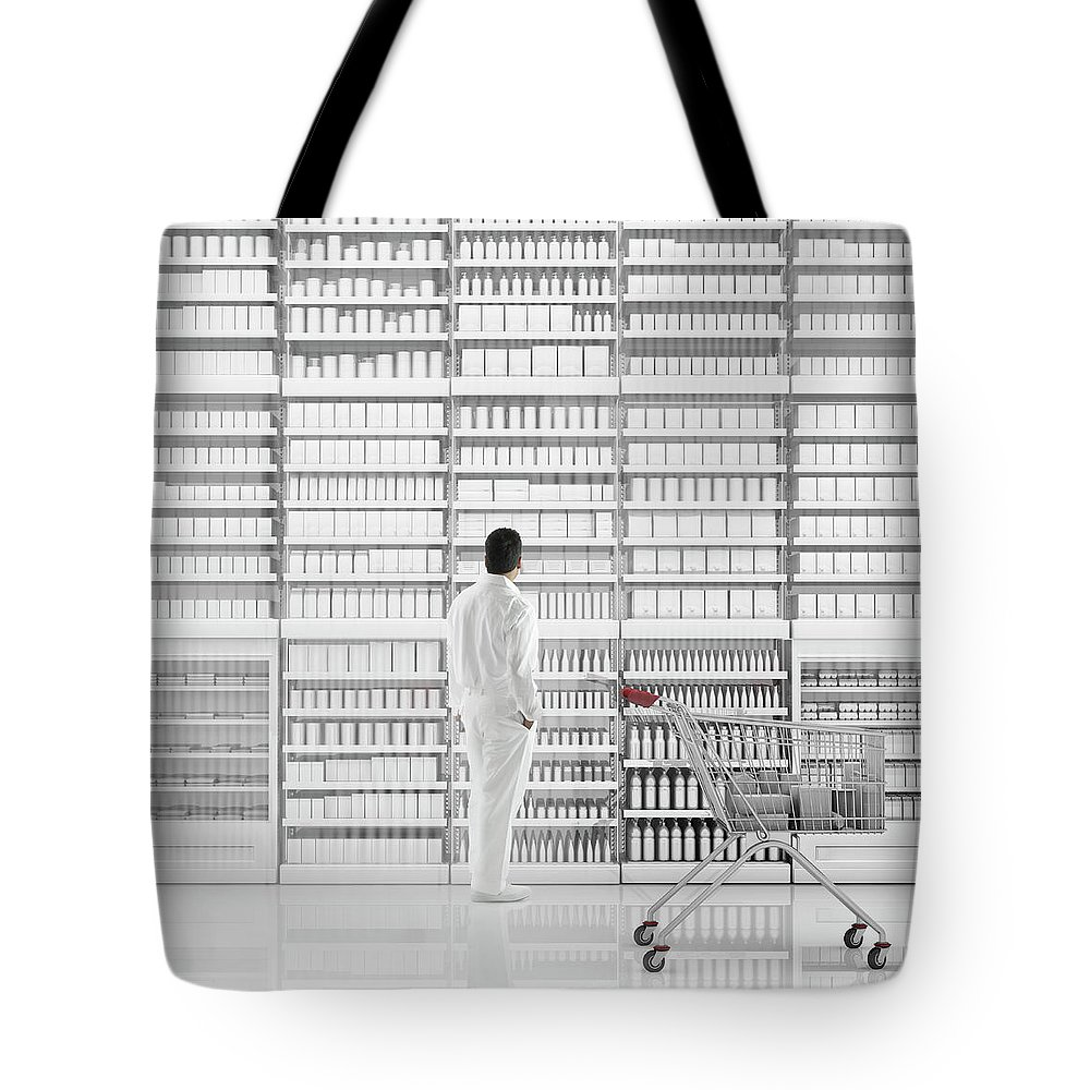 Internet Tote Bag featuring the photograph Mixed Race Man Shopping On White by Colin Anderson Productions Pty Ltd