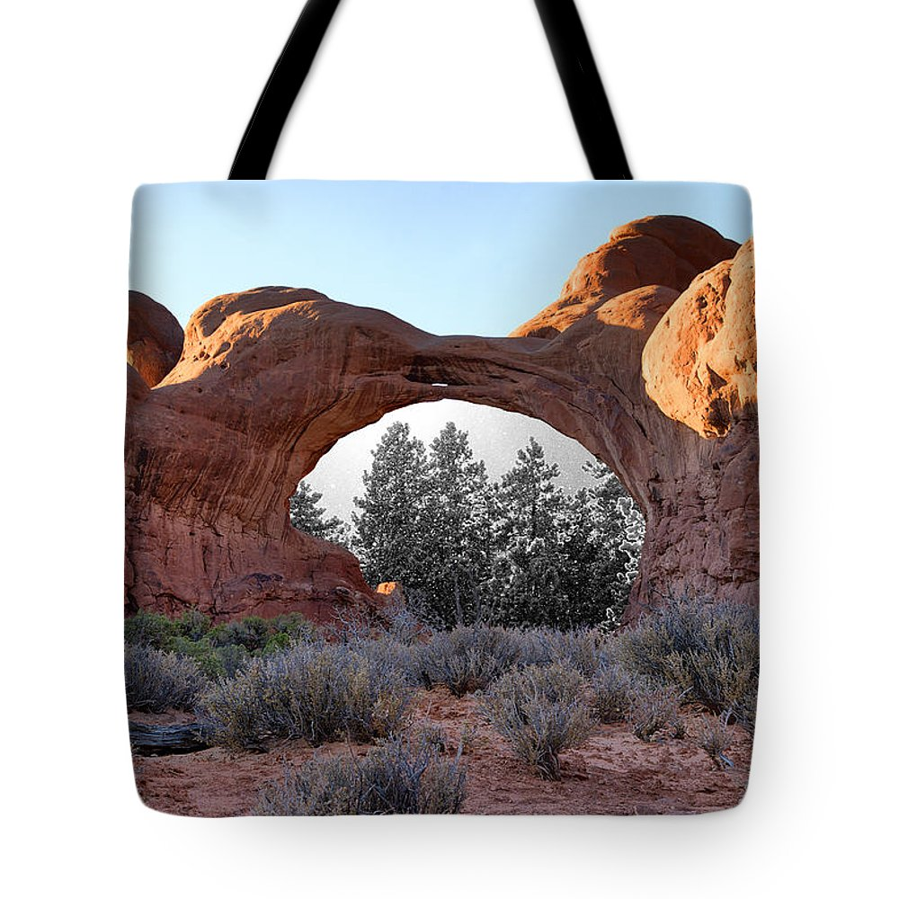 Moab Tote Bag featuring the photograph Moab Snow Globe by Greg Wells
