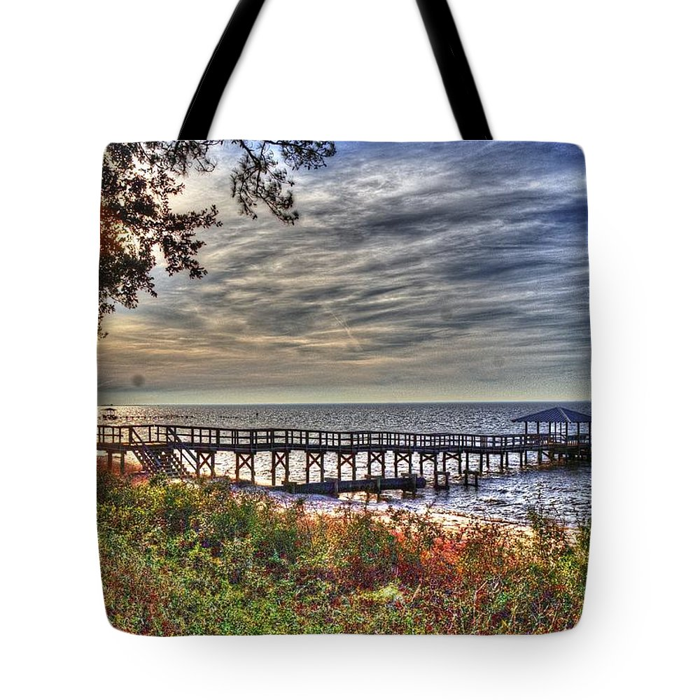 Sunset's Tote Bag featuring the photograph Mobile Bay Sunset by Paul Lindner