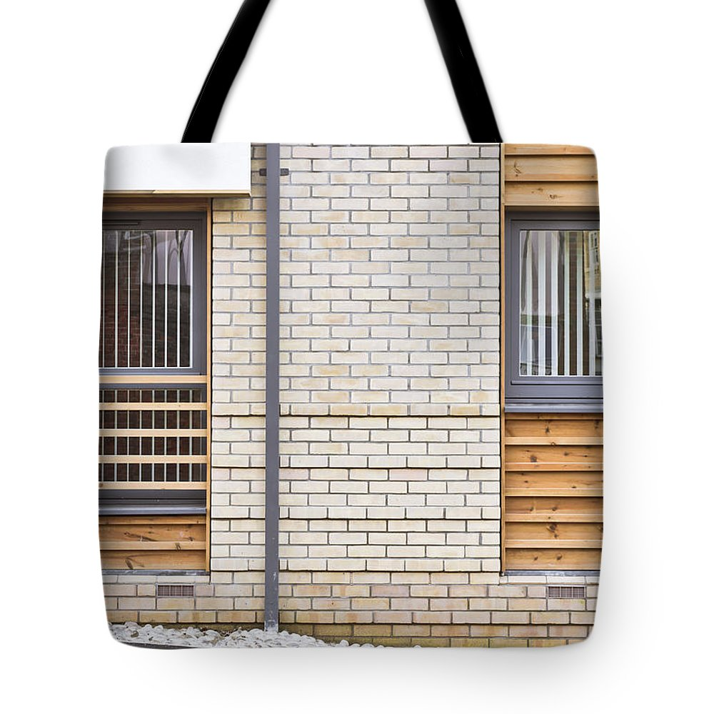 Apartments Tote Bag featuring the photograph Modern Apartment Windows by Tom Gowanlock