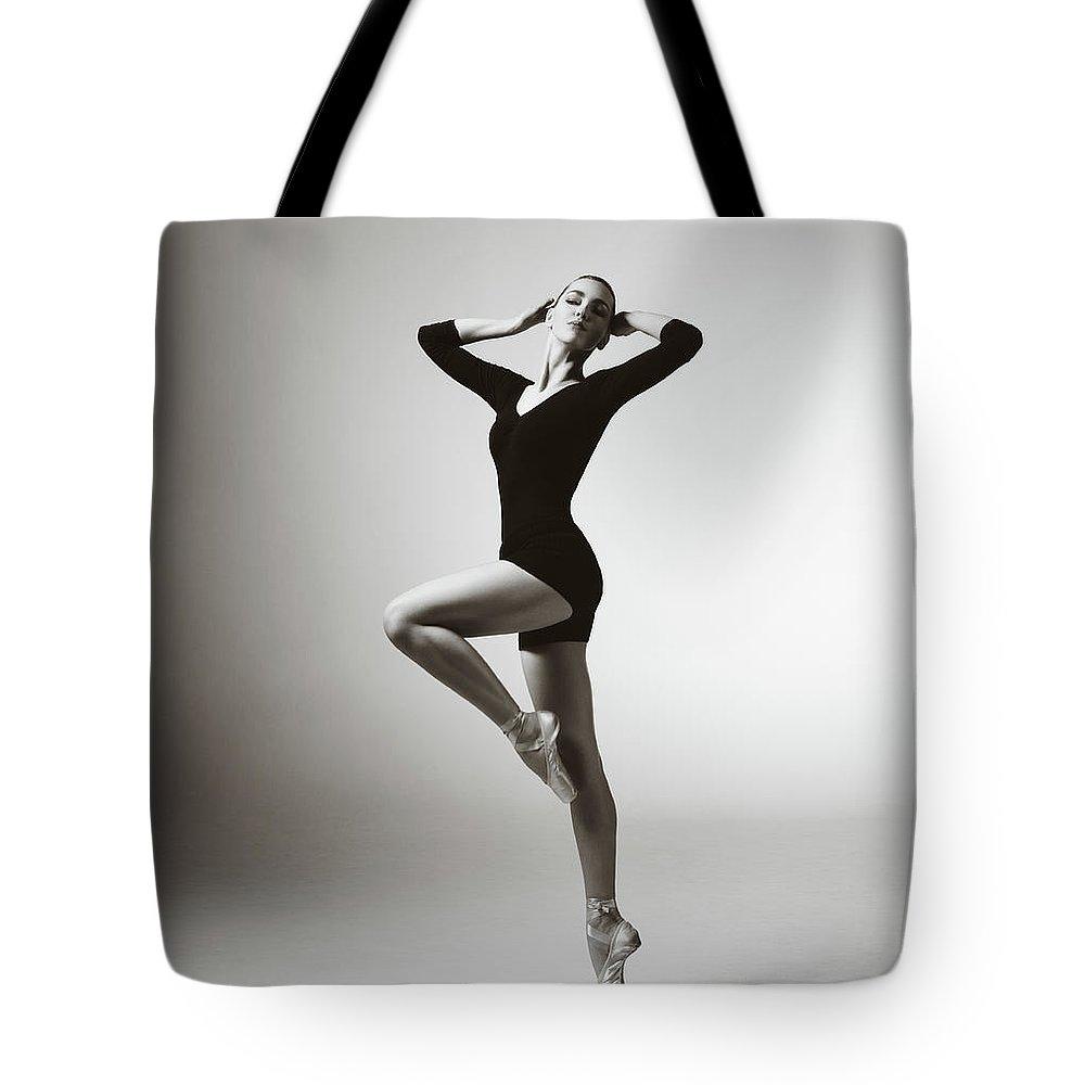 Ballet Dancer Tote Bag featuring the photograph Modern Dancer by Lambada
