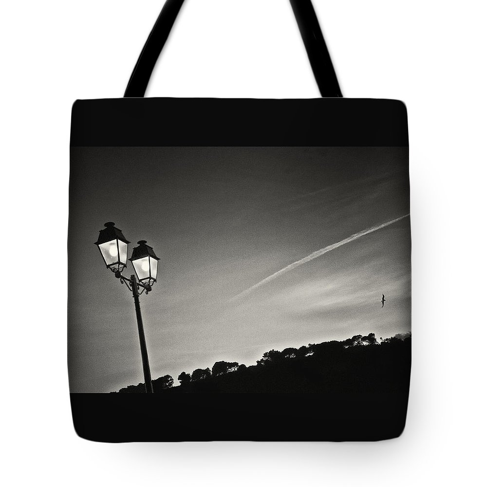 Photography Photographs Tote Bag featuring the photograph Moment Notice by Philippe Taka