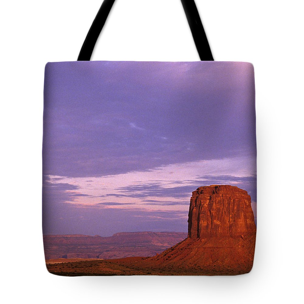 Adventure Tote Bag featuring the photograph Monument Valley Red Rock Formations At Sunrise by Jim Corwin