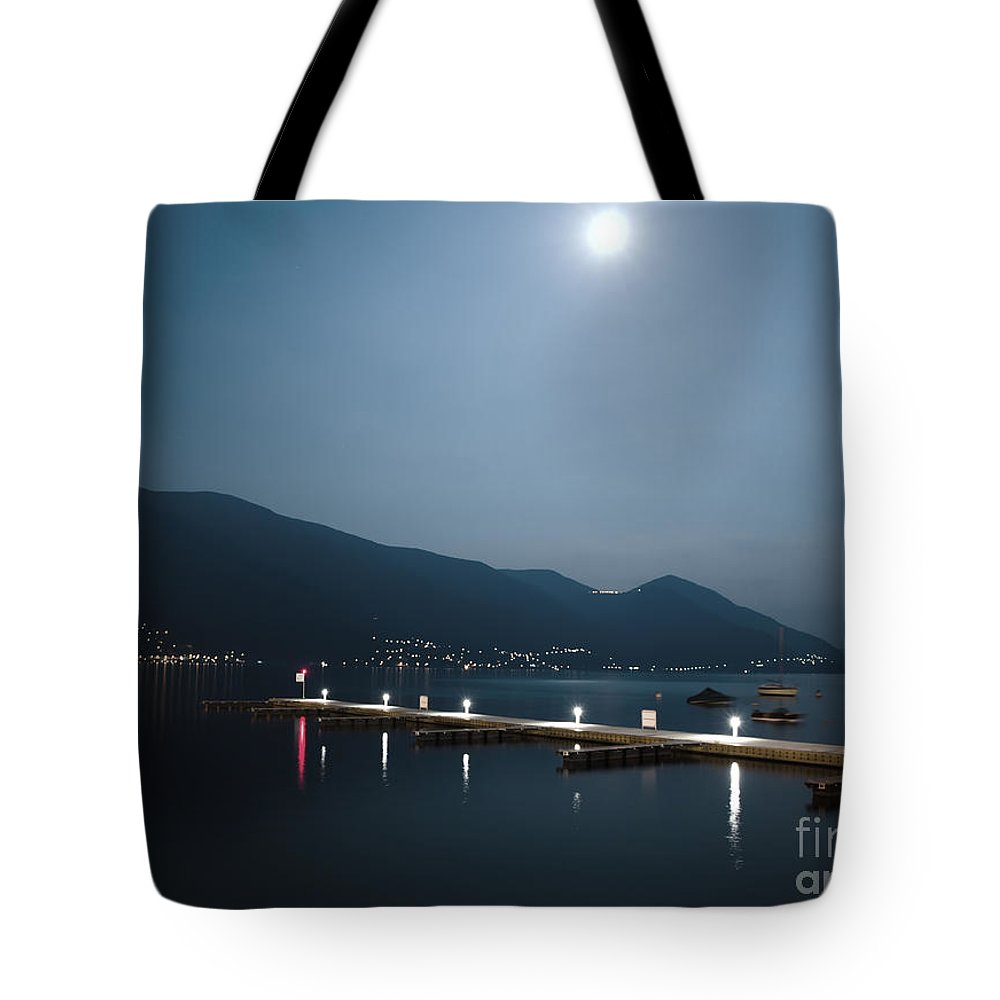 Moon Tote Bag featuring the photograph Moon Light And A Port by Mats Silvan