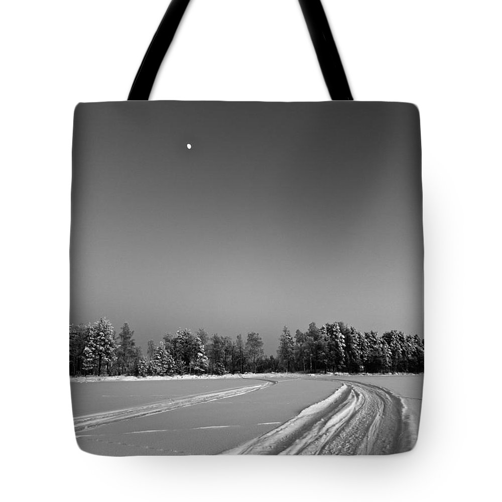 Photograph Tote Bag featuring the photograph Moon Over Ice Road by Ismo Raisanen