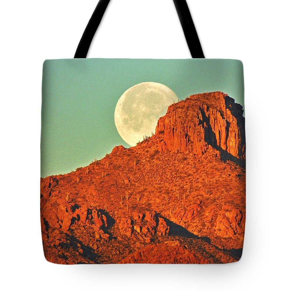 Moon Tote Bag featuring the photograph Moon Over Tucson Mountains by John Wanserski