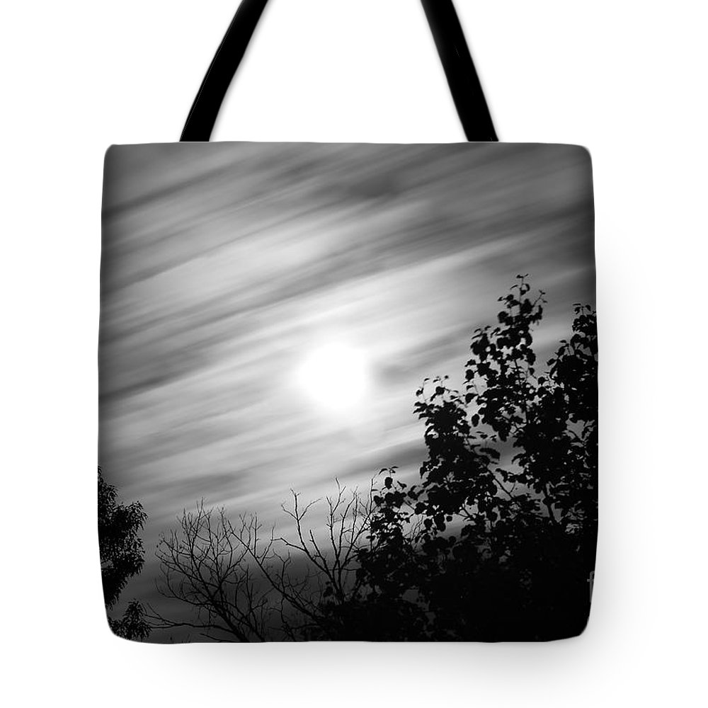 Moon Tote Bag featuring the photograph Moonlit Clouds by Todd Blanchard