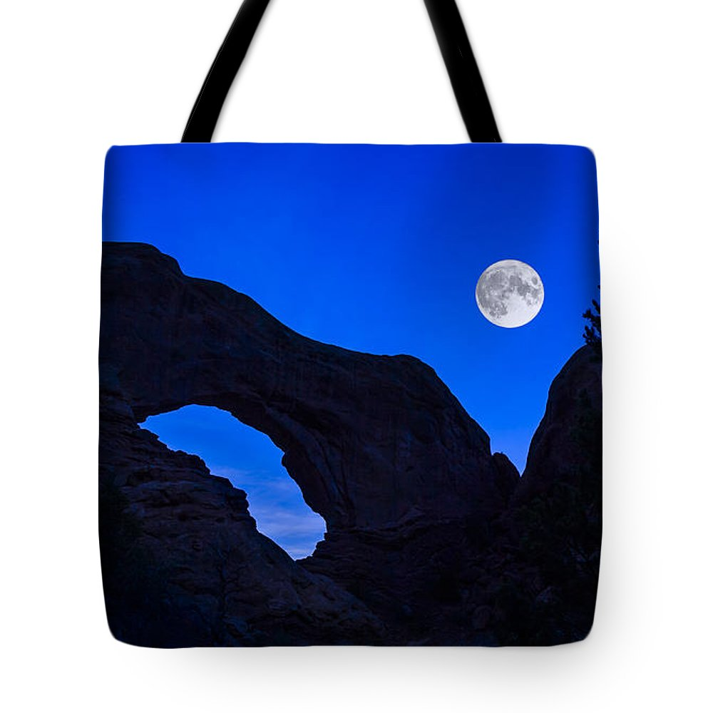 Arches National Park Tote Bag featuring the photograph Moonrise Over North Window Arch by Jeff Burton